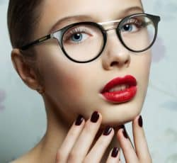 portrait of young beautiful woman with fresh clean skin. Perfect make up whith red lips.